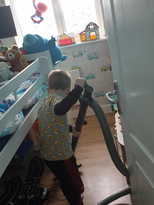 Zac doing one of his tasks....cleaning his room.