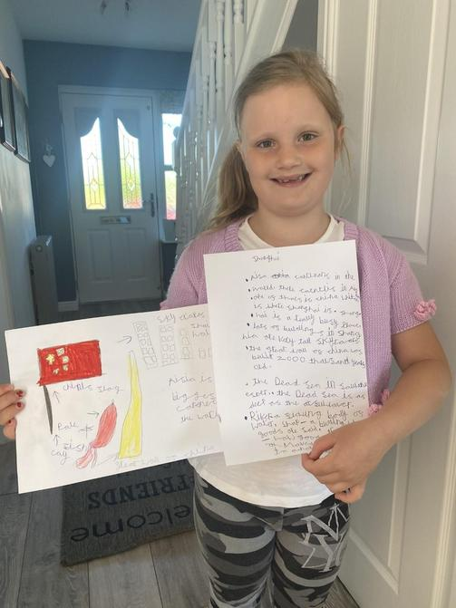 Olivia is very proud of her Geography work