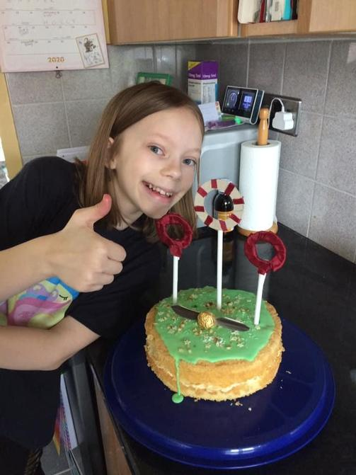 My Izzy turned 11 and made her own Quidditch cake!