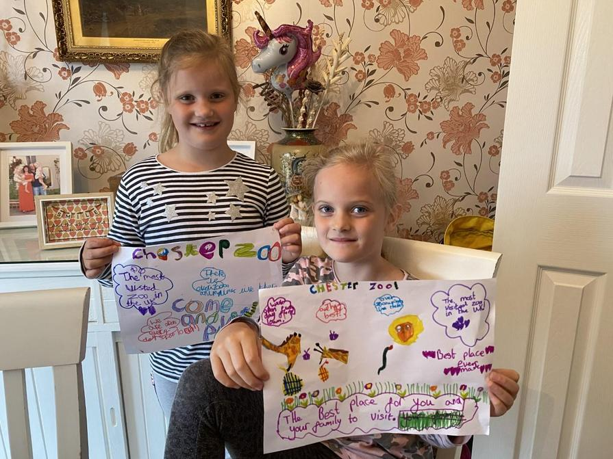 Olivia and Sophia's posters about Chester Zoo
