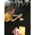 Lottie playing a game at home.