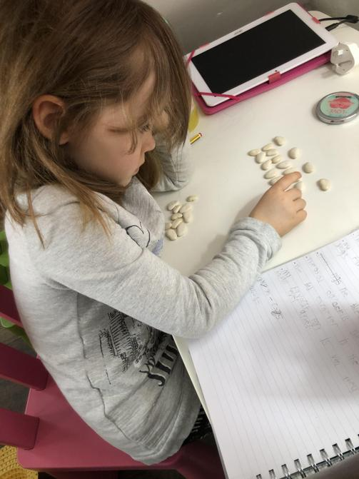 Olivia working hard with her division maths!