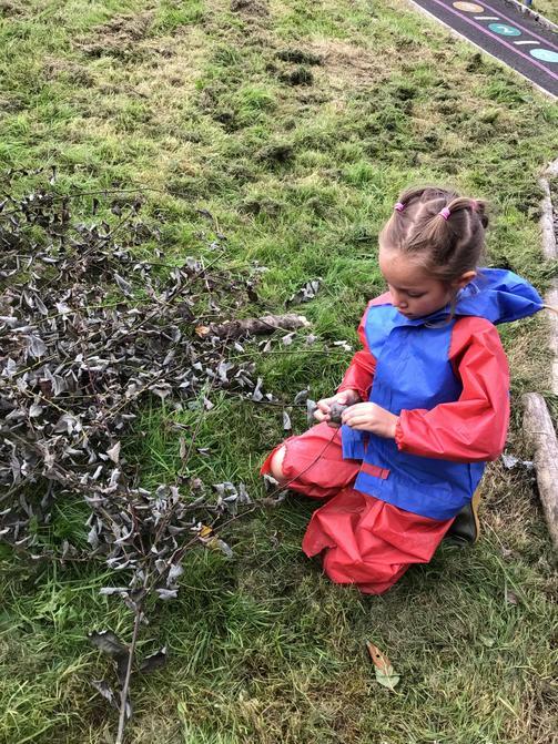 Using sticks to enhance her animal.