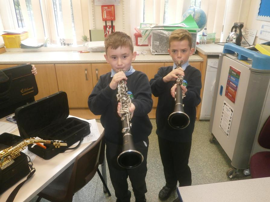 Working together to play their clarinets.