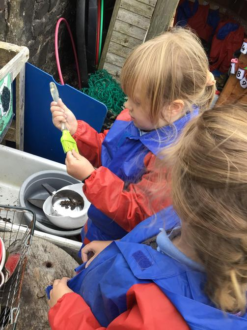 Creating potions in the mud kitchen.