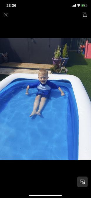Zac enjoying his pool.