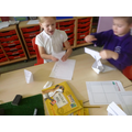 We followed instructions to make paper boats.