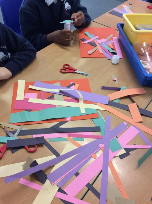 The children used strips of paper to create a pattern