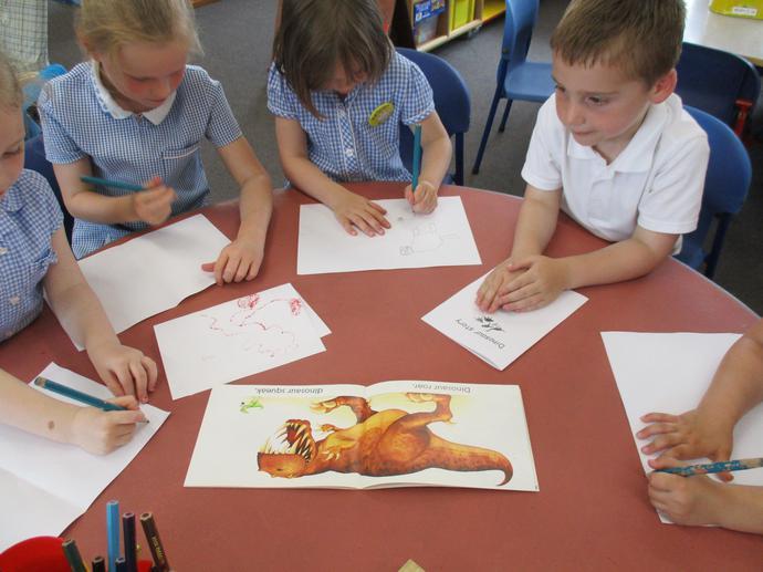 Writing dinosaur stories.