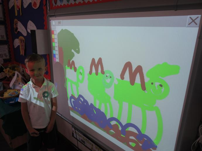 Drawing dinosaurs on the interactive whiteboard.
