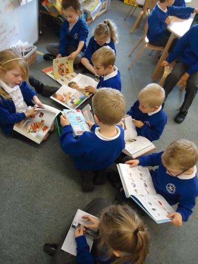 Yum! Reading recipe books.