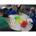 Making patterns at the maths table.