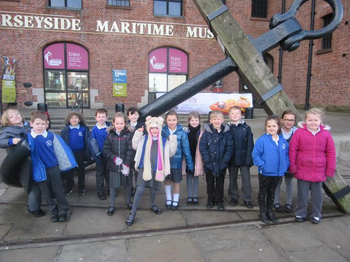 We all stood beside a giant anchor for a photo!