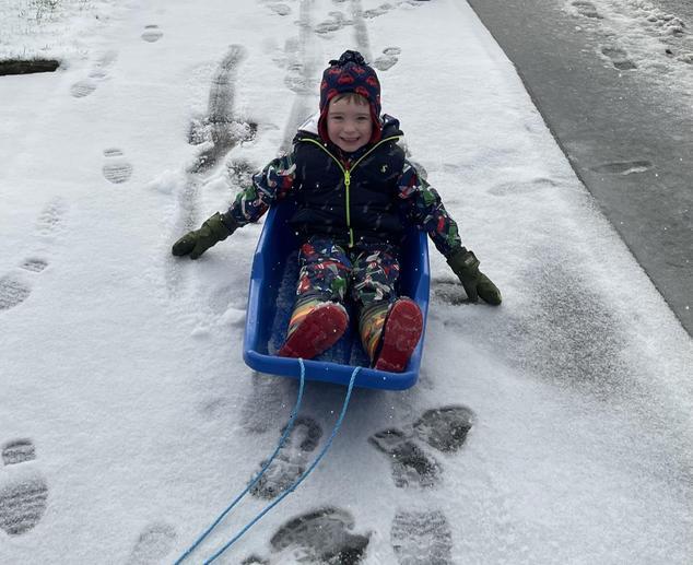 Elliot on his sledge.