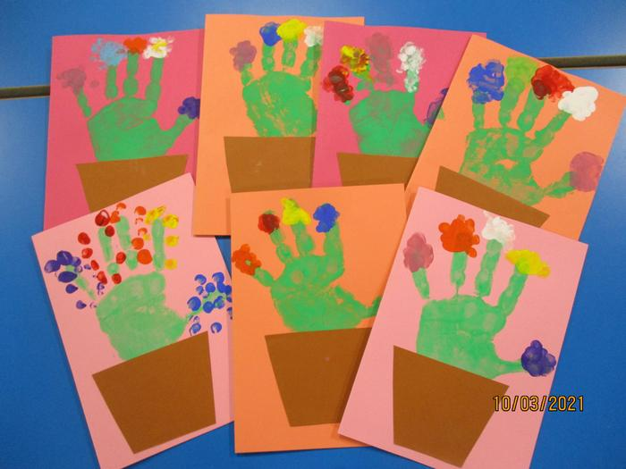 We used our hand and finger prints to make Mother's Day Cards