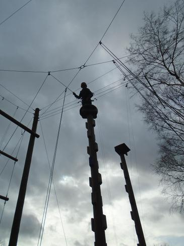 Climbing up the quad pole.