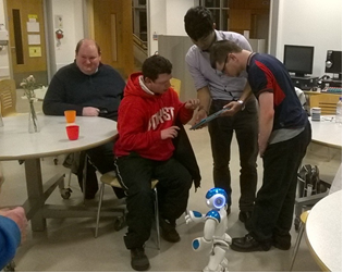 NICER group members testing the Nao robot interface with a researcher