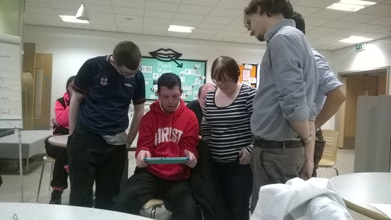 NICER group members testing an iPad application with a researcher