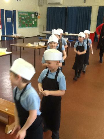 We got our aprons and hats on.
