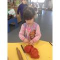 Using playdough to make characters.