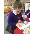 Writing a letter to Father Christmas.