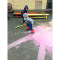 Making marks in the paint.