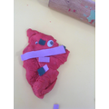 Using playdough to create story book characters.