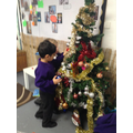 Helping to decorate the Christmas tree