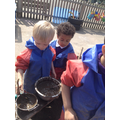 The children work together to make their mud soup.