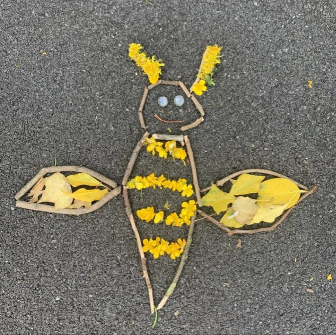 Bee made out of flowers, leaves + twigs by Bobby