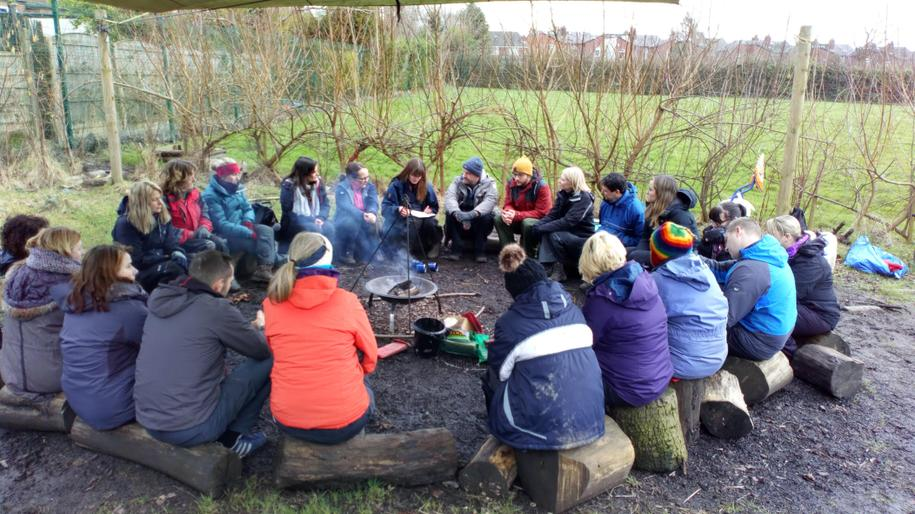Delegates sitting around the fire -Romiley Primary