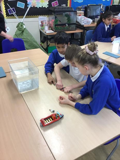 Investigating forces with plasticine boats.