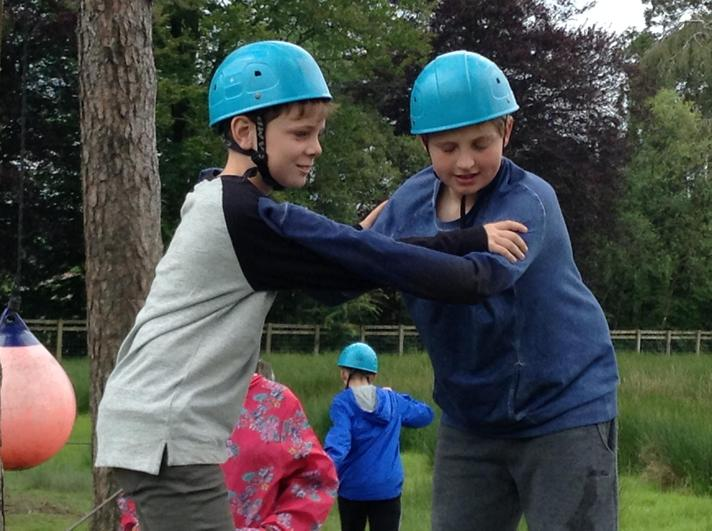 Helping each other on the Low Ropes Challenge