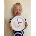 Lexi made a clock to practise telling the time