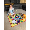 Isabella hosts a teddy bear picnic
