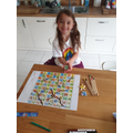 Isabella's snakes and ladders game.