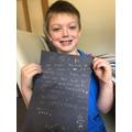 Archie's gold crayon letter
