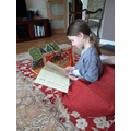 Emilie reading and playing Gruffalo pop up play