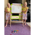 Lexi and Indie using Lego to practise their number bonds.