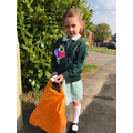 Alice collecting rubbish with Basil!  Well done!