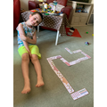 William playing with number bond dominos