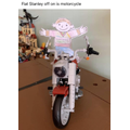 Flat Stanley off on his motorcycle