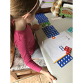 Josie practises adding 2 digit numbers