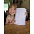 Daisy practising her phonics and number bonds.