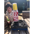 Teddy made a lighthouse with bubble wrap rocks