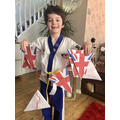 Teddy with his VE Day bunting & new Taekwondo belt