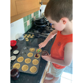 William making yummy jam tarts
