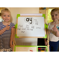 Lexi and Indie practise their phonics