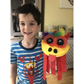 Teddy's colourful chinese lion puppet Ziggy.