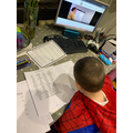 Quentin using the 'teach me' videos to help him with his work